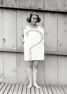naked woman holding a sign